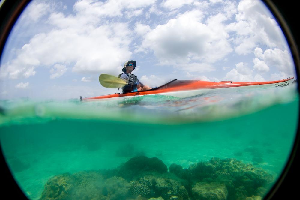 Kayaking above coral reef